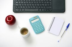 Computer keyboard, notebook, coffee on office desk,. Top view Royalty Free Stock Image
