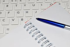 Computer keyboard, notepad and pen Stock Images