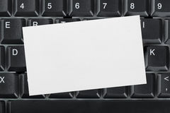 Computer keyboard and paper card Royalty Free Stock Photo