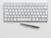 Computer keyboard and pen Royalty Free Stock Photos