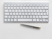 Computer keyboard and pen Royalty Free Stock Photos