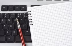 Computer keyboard and pen with notebook Stock Photography