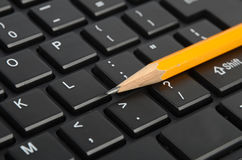 Computer keyboard and pencil Stock Photo