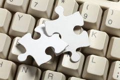 Computer Keyboard and Puzzle Stock Photography