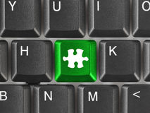 Computer keyboard with puzzle key Royalty Free Stock Photos