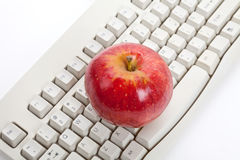 Computer Keyboard and red apple Stock Photo