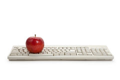 Computer Keyboard and red apple royalty free stock photography