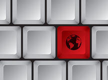Computer keyboard with red button with planet on it Royalty Free Stock Photography