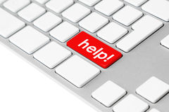 "Computer keyboard with red help button. Photo of a computer keyboard with one red key showing the word ""help!"" symbolising emergency, stress and frustration Stock Images"