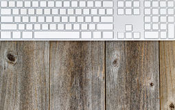 Computer keyboard on rustic wooden desktop Stock Image