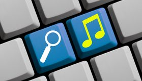 Computer Keyboard: Search Music. Computer Keyboard with Mouse arrow showing Music Search online Stock Photos