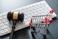 Computer keyboard , shopping cart and auction hammer on black. Background , online shopping concept Stock Image