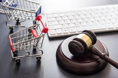 Computer keyboard , shopping cart and auction hammer on black. Background , online shopping concept Stock Photo