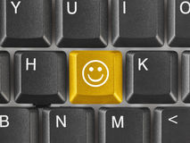 Computer keyboard with smile key Royalty Free Stock Photography