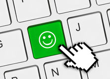 Computer keyboard with smile key Stock Photo