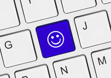 Computer keyboard with smile key Stock Image
