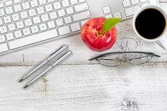 Computer keyboard with snack foods on top of old desktop Stock Photography