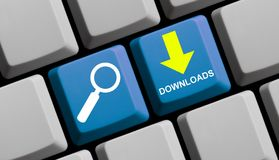 Search Downloads online - Computer Keyboard. Computer Keyboard with symbols is showing search Downloads online royalty free stock photos