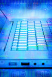 Computer Keyboard Technology. A laptop computer keyboard with a circuit board background overlaid on top Royalty Free Stock Image