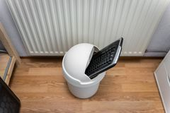 Computer Keyboard in Trash Can royalty free stock photography
