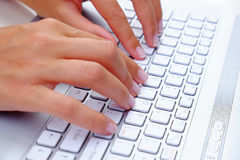Typing Keyboard. Business Lady texting on a white laptop or computer keyboard Stock Photography