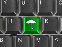 Computer keyboard with umbrella key Stock Images
