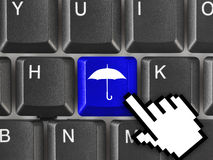 Computer keyboard with umbrella key Stock Photos