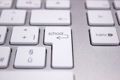Computer keyboard with word concerning the school. Image with text on keyboard keys concerning the school and the education Stock Image