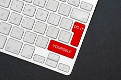 Keyboard do it yourself on the black background stock image