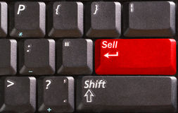 Computer keyboard with word Sell on red button Stock Images