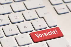 Computer keyboard with the word vorsicht Stock Photography