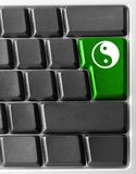 Computer keyboard with yin yan key Stock Photo
