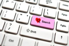 Computer keybord with word search and heart icon, selected focus stock image