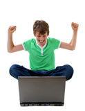 Computer Kid. Happy boy looking at laptop computer Stock Photography