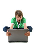Computer Kid. Angry boy looking at laptop computer Stock Image