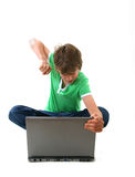 Computer Kid. Angry boy punching  laptop computer Royalty Free Stock Images