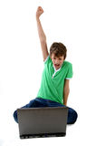 Computer Kid. Happy boy in front of  laptop computer Stock Photos