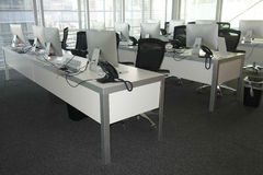 Computer Lab. Three rows of white computers on desks Royalty Free Stock Photography