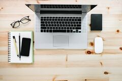 Free Computer Laptop And Digital Devices On Table Workspace, Top View Of Creative Working Home Office Desktop With Laptop Device. Royalty Free Stock Photo - 217847205