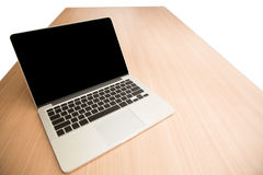 Computer laptop with blank screen and blank keyboard on wooden t Stock Images