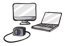 A computer, a laptop and a camera Stock Photos
