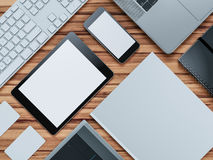 Computer, laptop, digital tablet, mobile phone, virtual headset and newspaper on wooden table. IT concept. Royalty Free Stock Images