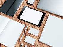Computer, laptop, digital tablet, mobile phone, virtual headset and newspaper on wooden table. IT concept. Royalty Free Stock Photo