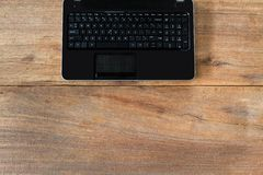 Computer laptop on grunge vintage wooden table. Business concept Stock Photos