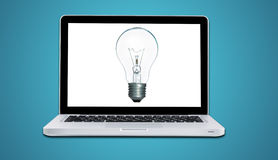 Computer laptop with lamp bulb ideas concept isolated Stock Image