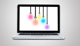 Computer laptop with lamp bulb ideas concept isolated Royalty Free Stock Images