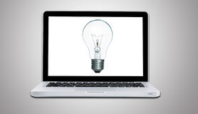 Computer laptop with lamp bulb ideas concept isolated Royalty Free Stock Photo