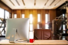 computer, laptop, office supplies, and coffee cup at fitness. stock photo