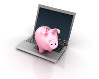 Computer Laptop and Piggy Bank Stock Image