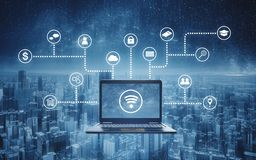 Computer laptop with wireless and application programming and social media icons. Internet networking and wireless technology stock photography